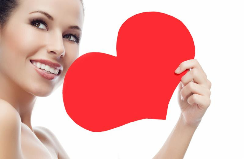 beauty portrait of attractive  caucasian smiling young woman isolated on white studio shot face skin red heart valentine s love
